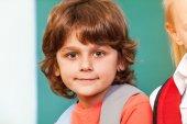 Cute schoolboy looking straight — Stock Photo