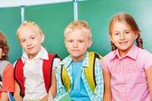 Three kids stand together — Stock Photo