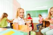 Desk rows with children — Stock Photo