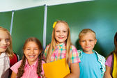 Smiling children stand  together — Stock Photo