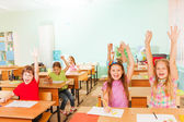 Happy children with arms up — Stock Photo