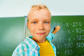 Boy with chalk during mathematics lesson — Stock Photo