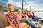 Relaxing kids with skateboards — Stock Photo