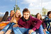 Happy kids sitting together — Stock Photo