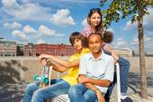 Friends sitting with skateboard — Stock Photo