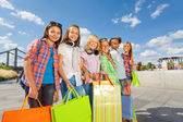 Girls with shopping bags walking together — Stock Photo