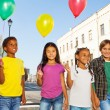 Children standing with colorful balloons — Stock Photo #60954909