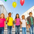 Children standing with colorful balloons — Stock Photo #60954915