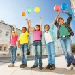 Children standing with colorful balloons — Stock Photo #60954925