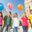 Children standing with colorful balloons — Stock Photo #60954937