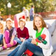 Girl with skateboard and friends — Stock Photo #60955295