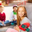 Girl with skateboard and children — Stock Photo #60955301