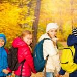 Happy children wearing rucksacks — Stock Photo #60955861