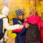 Kids standing close with rucksacks — Stock Photo #60955869