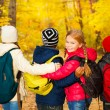 Kids group standing close with rucksacks — Stock Photo #60955881