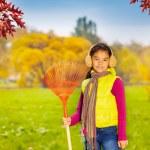 Girl with big red rake — Stock Photo #60956203