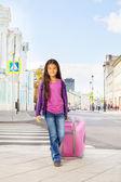 Asian girl holding luggage — Foto Stock