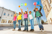 Children standing with colorful balloons — Stock Photo