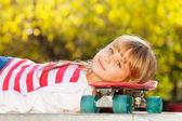 Smiling girl with skateboard — Stock Photo