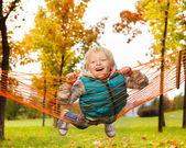 Blond boy laying on hammock — Stock Photo