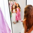 Girls with dresses in the mirror — Stock Photo #65909005