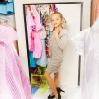 Little girl trying on dress — Stock Photo #65961313