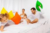 Parents and kids play with pillows — Stock Photo