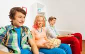 Happy teenagers  siting on sofa — Stock Photo