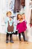 Girl and boy in clothes store — Stock Photo