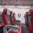 Row of red sits in airplane — Stock Photo #65984987