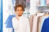 African boy in shop holding shopping bag — Stock Photo