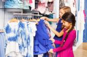 Small girls shopping in clothes store — Stock Photo