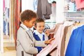 Boys choose clothes in store — Stock Photo