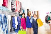 Girls and boy with shopping bags — Stock Photo