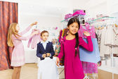 Children standing in clothing store — Stock Photo