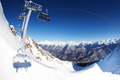 Chair lift ropeway panorama over mountain — Stock Photo