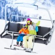 Mother with boy lifting on ski lift — Stock Photo #65991431