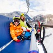 Boy and mother on ski lift chair — Stock Photo #65993619
