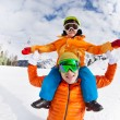 Father and son sitting on shoulders in mountain — Stock Photo #65993897