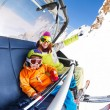 Mom with boy on ski lift chair — Stock Photo #65995779