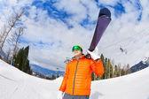 Man wearing mask holds ski — Stock Photo