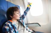 Boy with toy plane in airplane — Стоковое фото