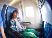 Little boy in airplane seat — Stock Photo