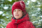 Boy with falling snow ine forest — Stock Photo