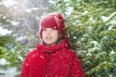 Boy in winter near fir tree — Stock Photo