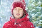 Boy with closed eyes and falling snow — Stock Photo