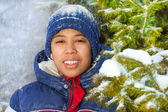 Smiling boy in forest with snowflakes — 图库照片