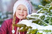 Girl with green fir brush-wood — Stock Photo