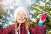 Girl with fir tree and snow — Stock Photo