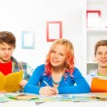 Boys and girl do homework — Stock Photo #77367650